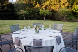 """The East Garden and Courtyard, our 66"""" tables - Krishna Muirhead Photography"""